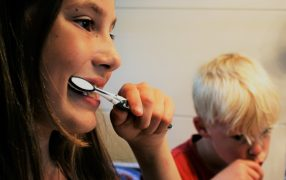 how to brush autistic child's teeth
